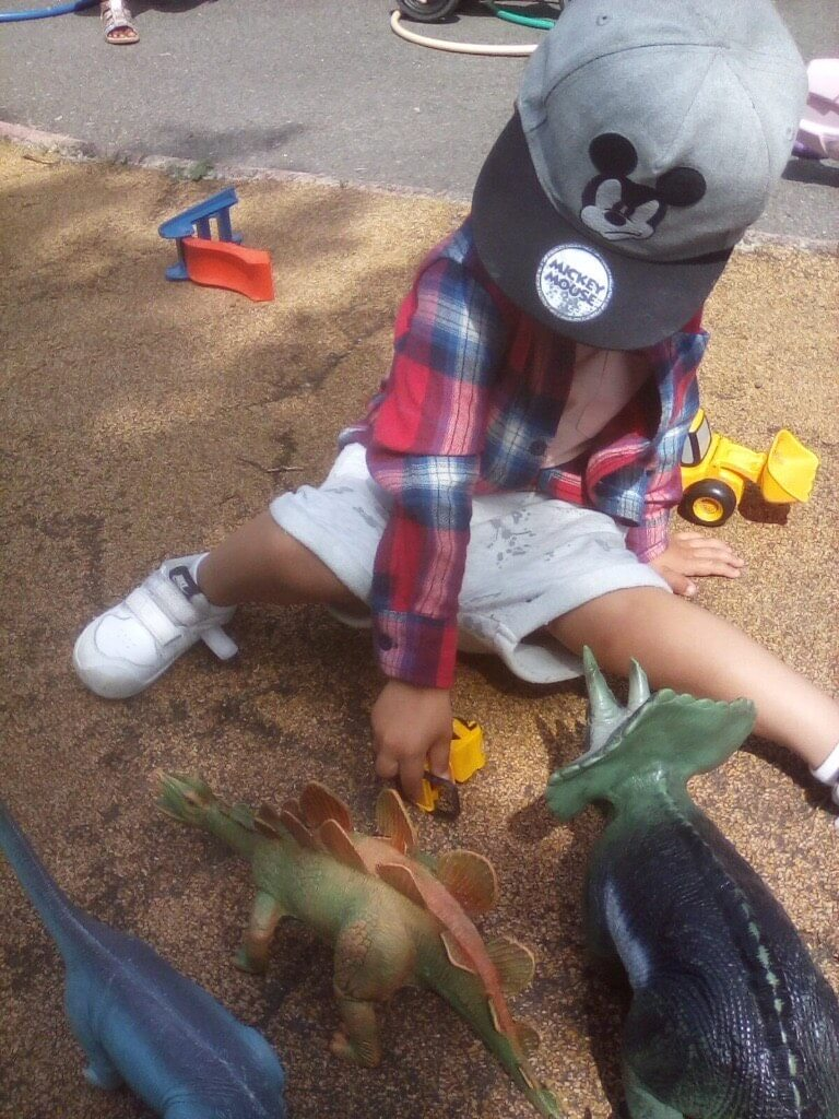 A kid playing with toys